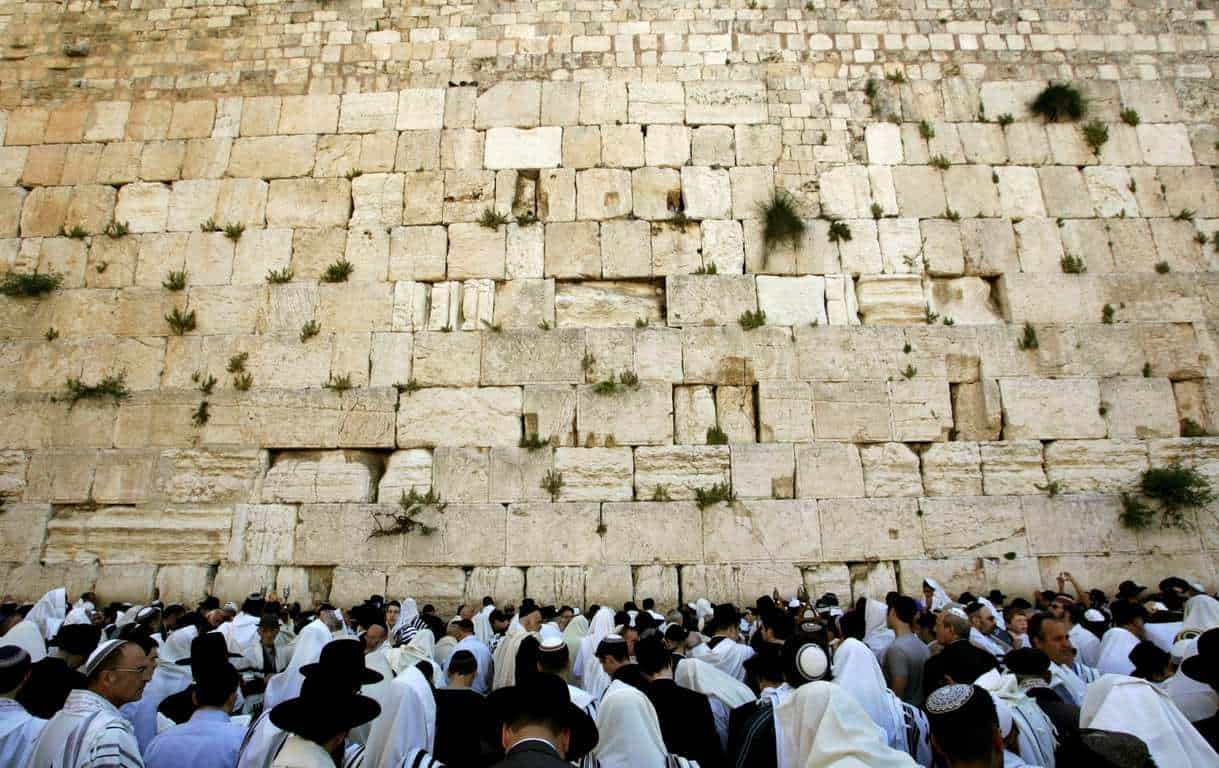 26 Apr 2005, JERUSALEM, Israel --- Ultra-Orthodox Jewish men pray during Passover prayers at the Western Wall in Jerusalem's Old City April 26, 2005. --- Image by © OLEG POPOV/Reuters/Corbis