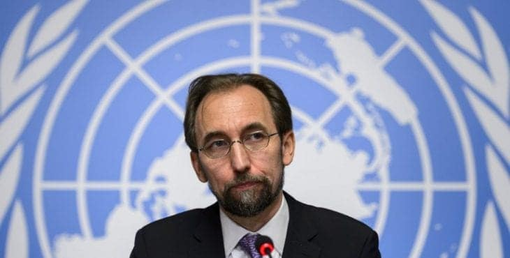 New High Commissioner of the United Nations (UN) for Human Rights, Zeid Ra'ad al-Hussein of Jordan (C) attends a press conference on October 16, 2014 in Geneva. AFP PHOTO / FABRICE COFFRINI