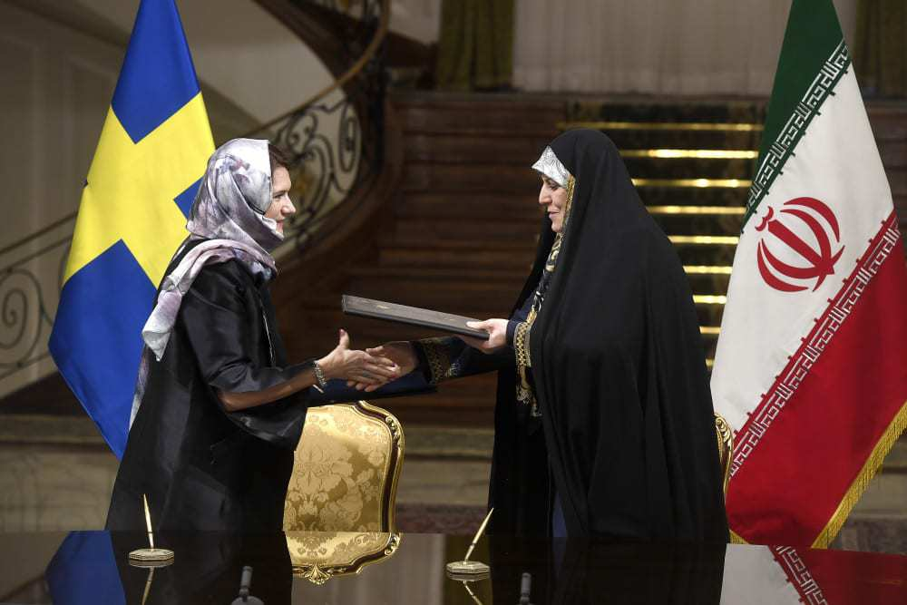 Sweden defends officials wearing headscarves in Iran